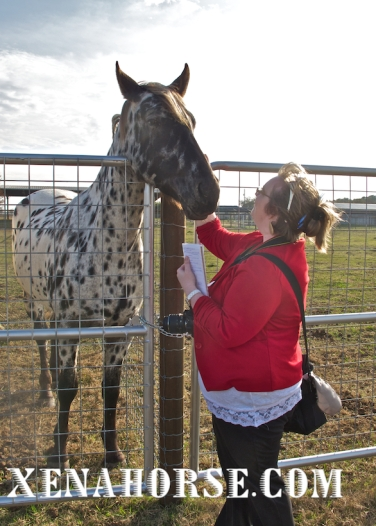 """Fort Bend Herald reporter Jennifer Scott meets mascot """"Xena,"""" December 2014."""