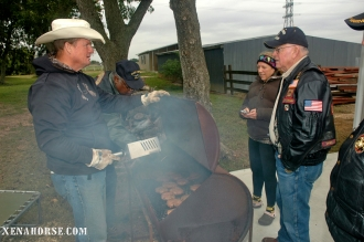 Former Marine Keith Shultis, Chairman of the Board, The Xena Project, serves up lunch to volunteers.