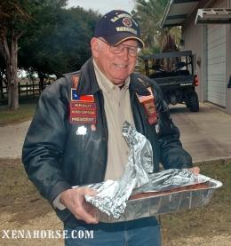 Board member and former Marine John Echoff serves BBQ.