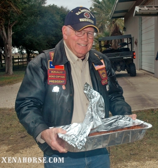 Board member and former Marine John Echoff serves BBQ.